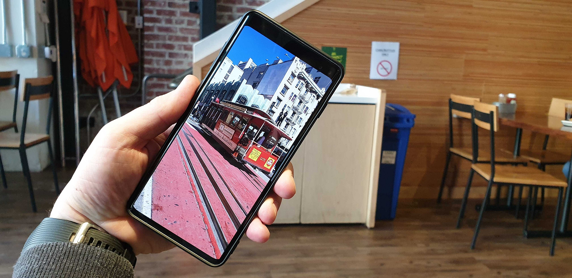 Yes, the Galaxy S10 has an option to hide the front camera cutout